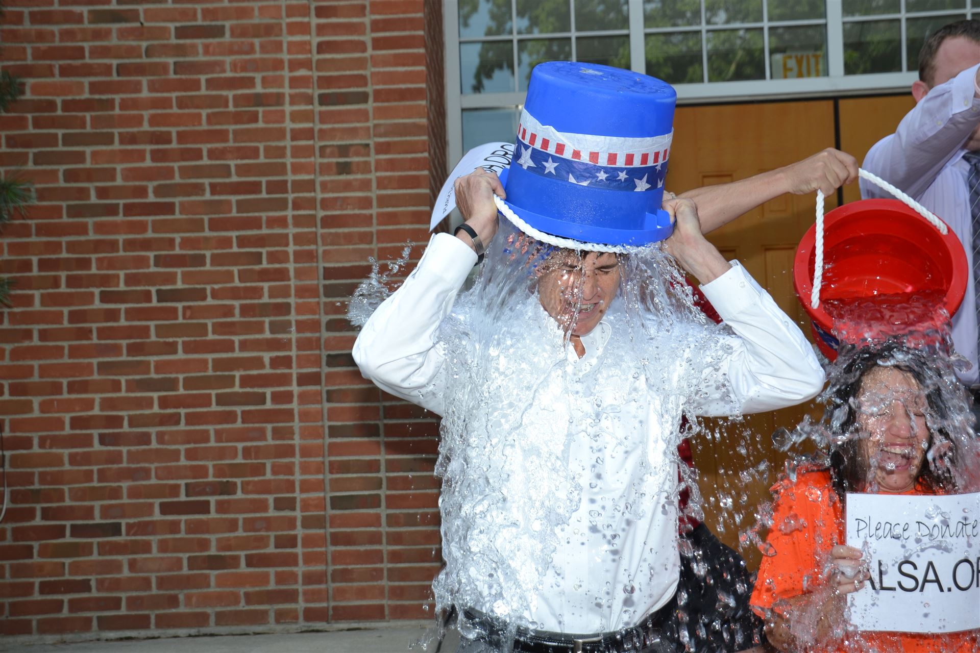 Dr. John Kellogg dumps a bucket of ice water over his head