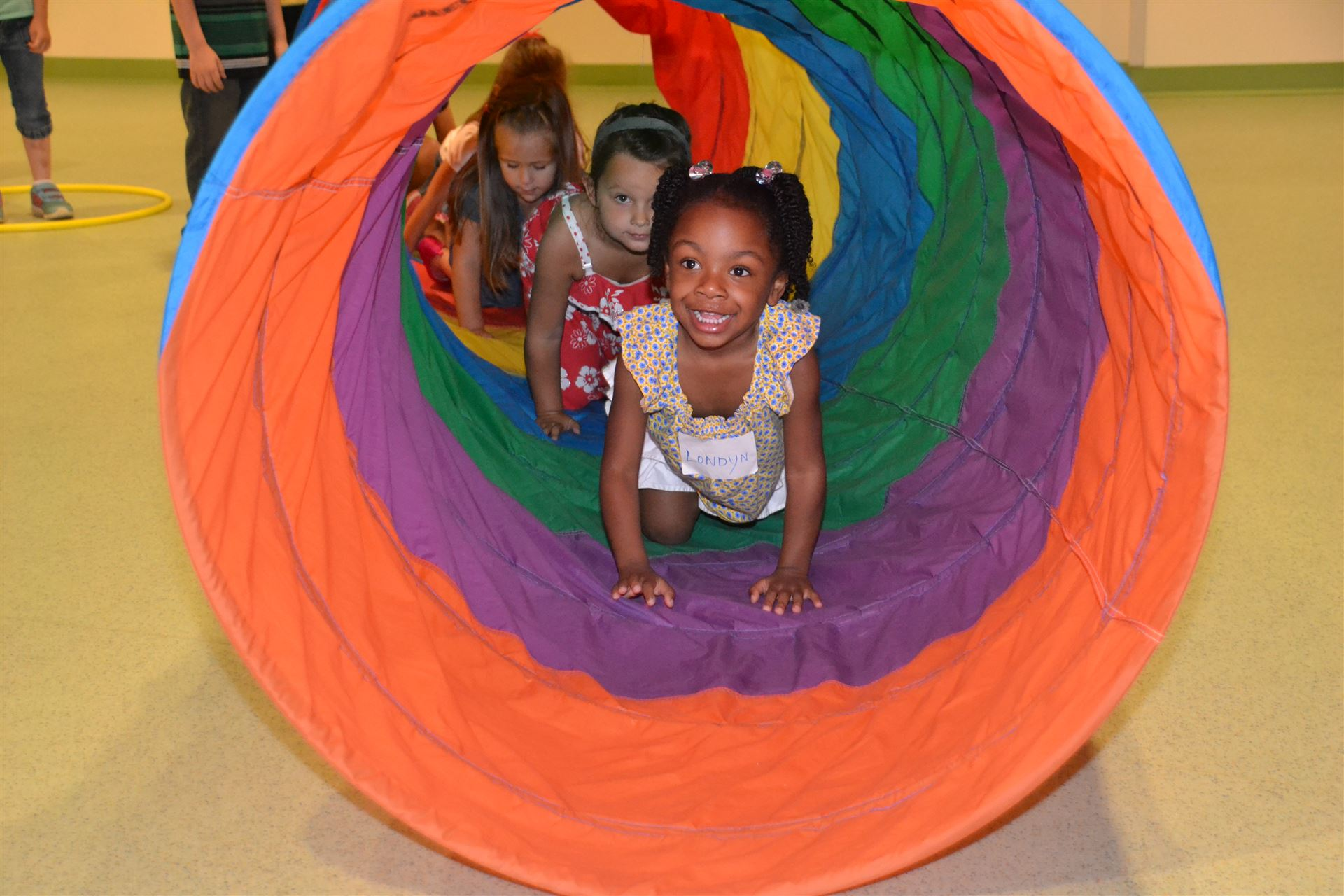 Students in a play tunnel