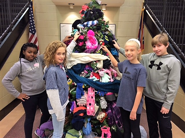 Student Council members with the mitten tree