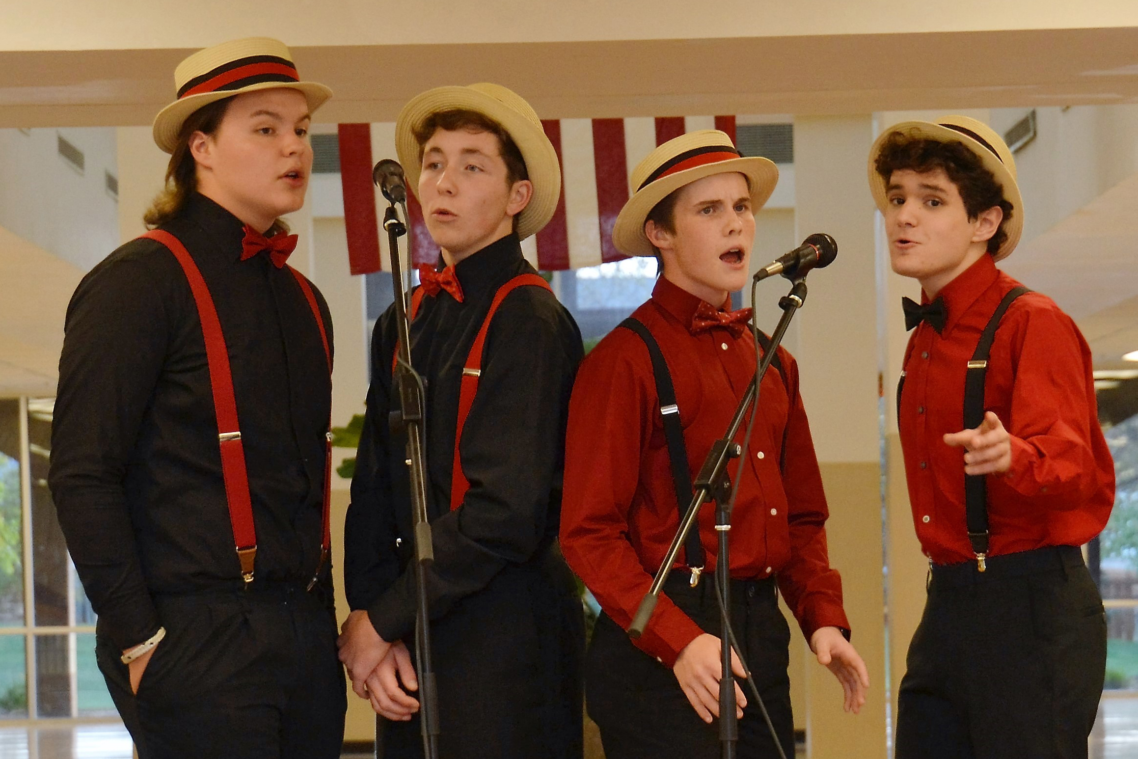 Four Westerville North High School students singing as a barbershop quartet and entertained guests