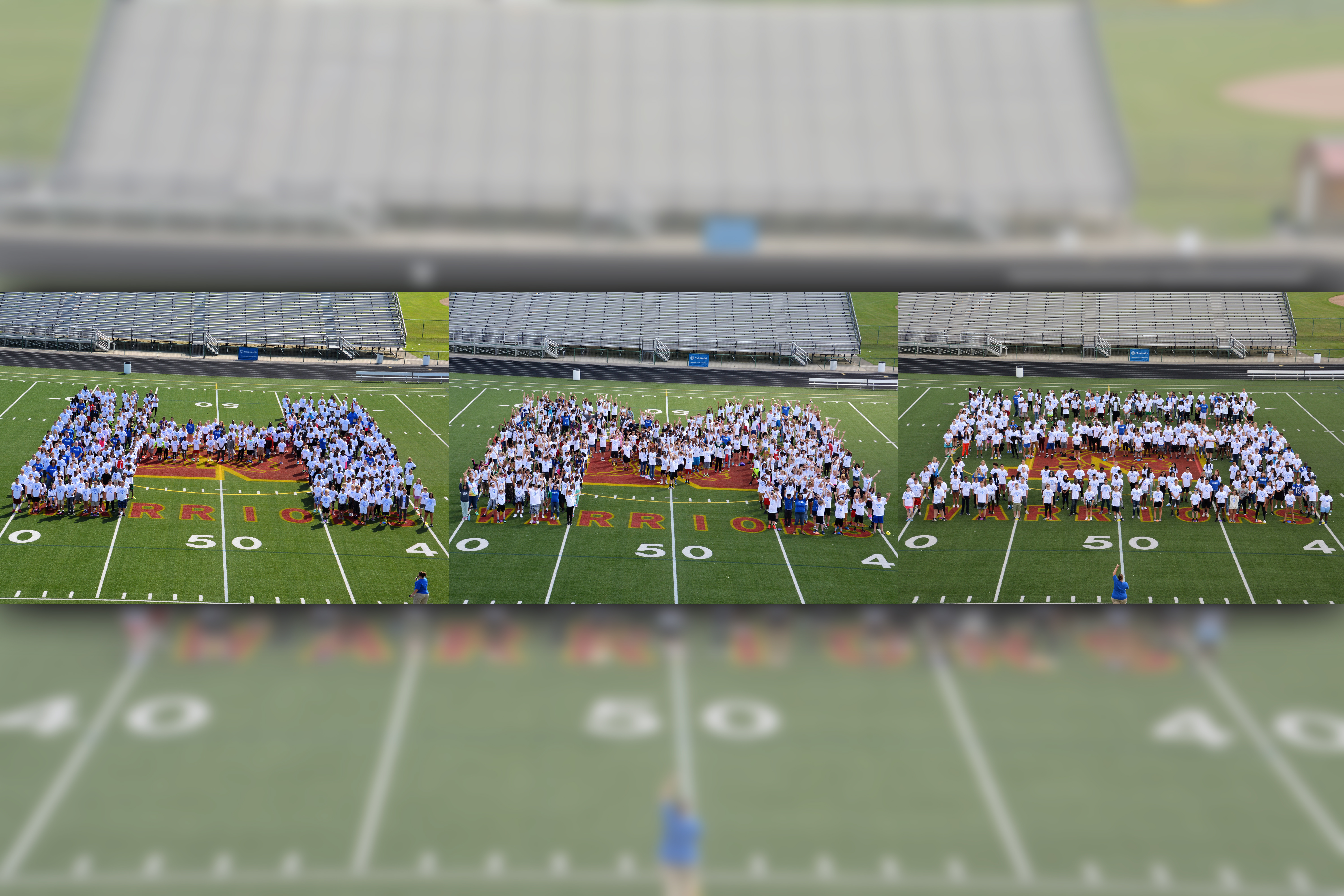 Students form the Heritage Middle School initials on the football field at Westerville North.