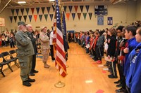 pupils stand and recite the Pledge of Allegiance
