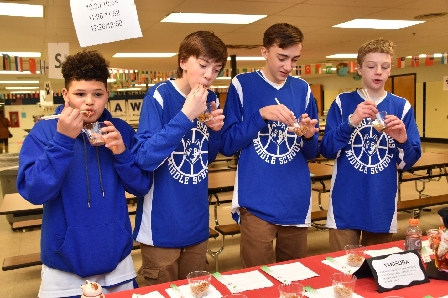 Walnut students try eating with chopsticks