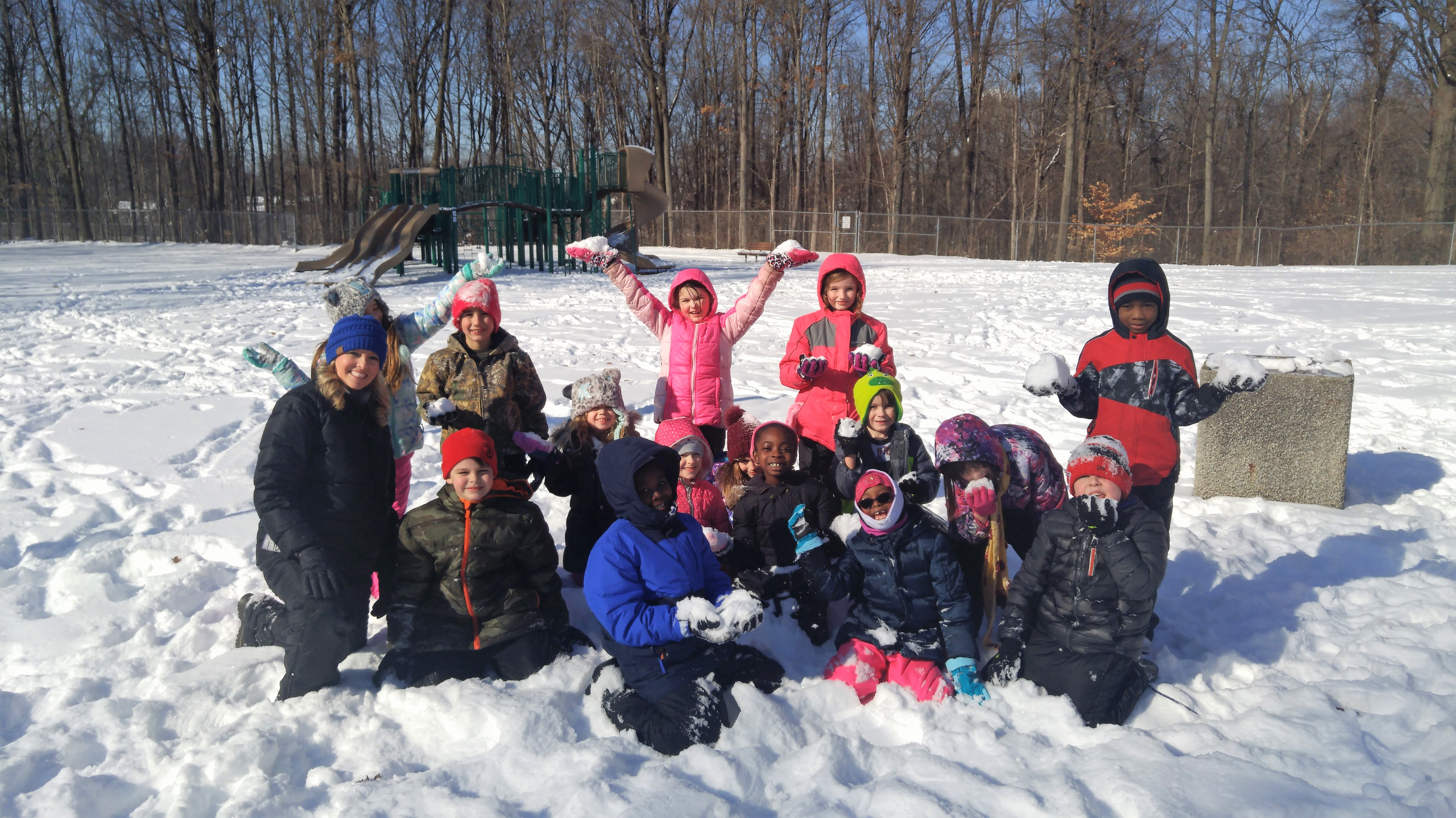 Second graders playing in the snow