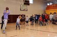 Students to shooting hoops