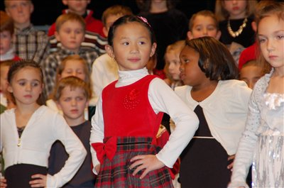 First grade students from Alcott Elementary performed 18 multi-cultural winter holiday songs before a packed auditorium at Westerville Central on December 11.