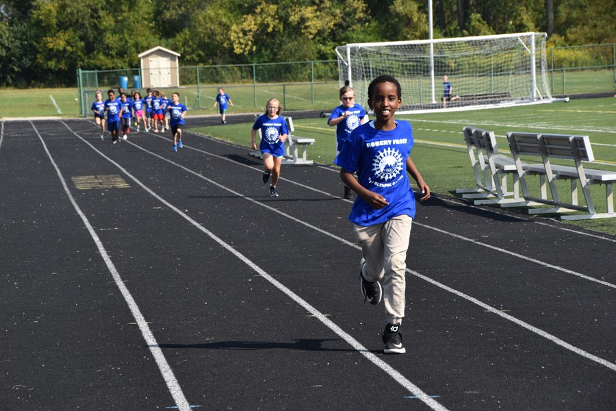 Robert Frost Elementary School students from running and walking around the track