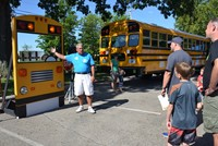 First Time School Bus Riders Gather to Learn About Safely Being Transported