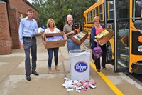 Superintendent John Kellogg, along with Board of Education members unload school supplies.