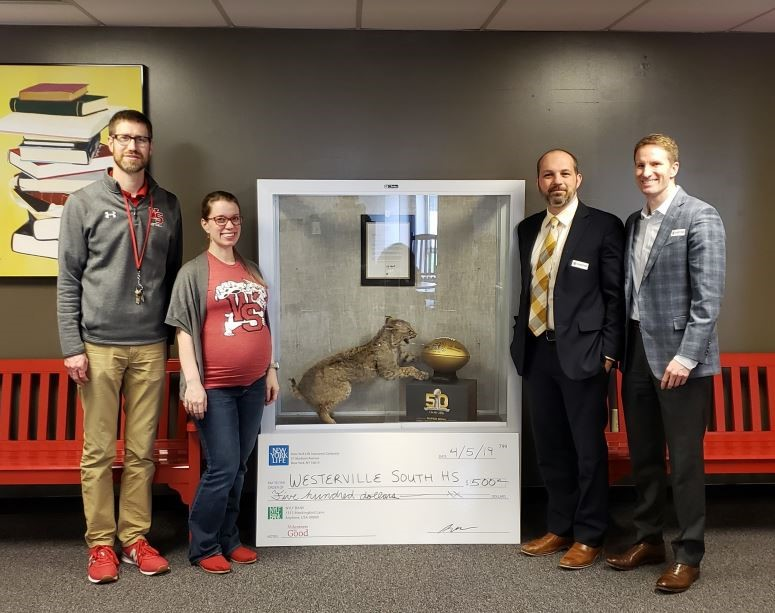 Westerville South Principal Mike Hinze and Student Assistance Counselor Noelle Spriestersback are pictured with Agents and Grief-Sensitive Program Ambassadors Erik Brown, CFP and Chris Rhorer of New York Life's Columbus General Office.