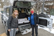 Tami Santa and Anne Baldwin provide gifts for counselors