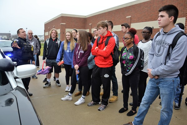 Central students and Genoa police foster relationships through Bridge program.